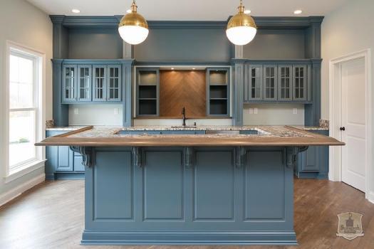 Blue Kitchen With Wood Herringbone Tile Backsplash