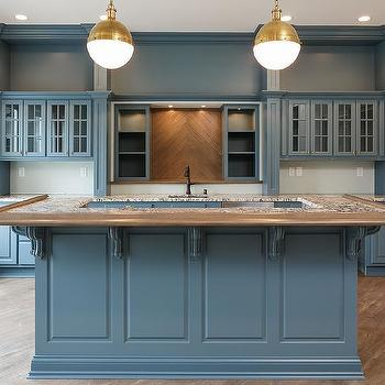 Blue Kitchen With Wood Herringbone Tile Backsplash