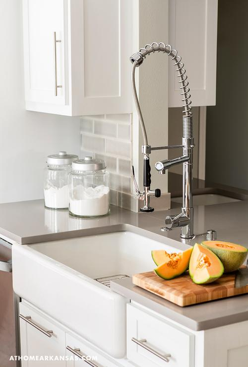 White Kitchen Cabinets With Gray Quartz Countertop And