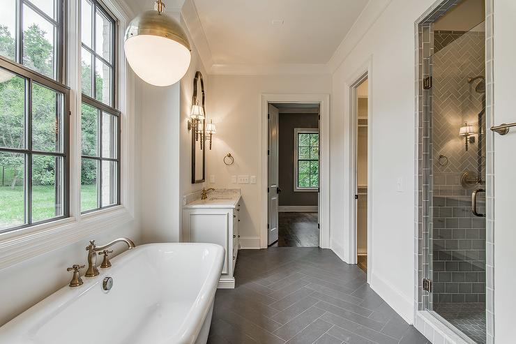 dark gray herringbone tile floor
