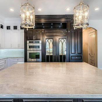 Black Kitchen Island With Taj Mahal Quartzite Countertop