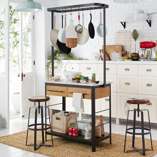 white marble kitchen island and pot rack