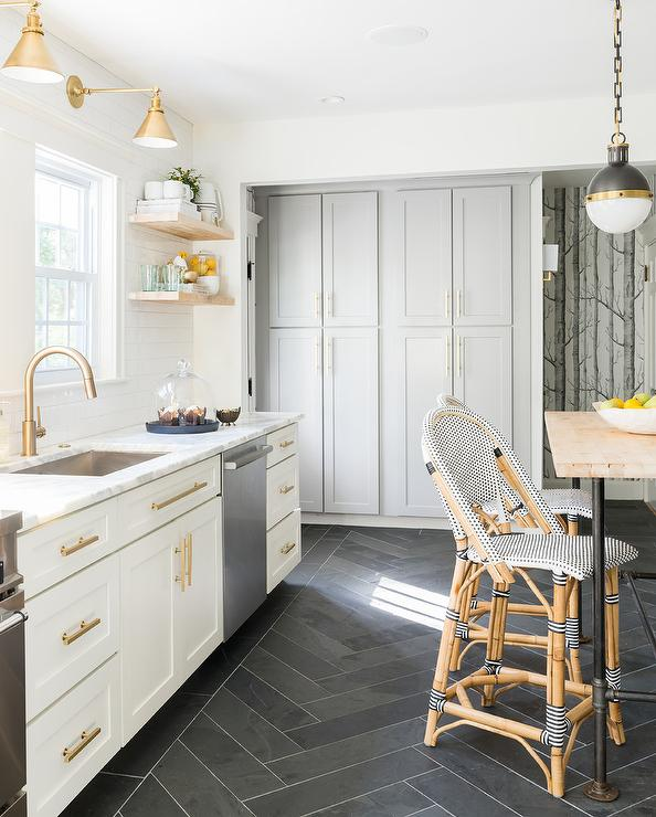 White And Gold Kitchen With Black Herringbone Floor Tiles
