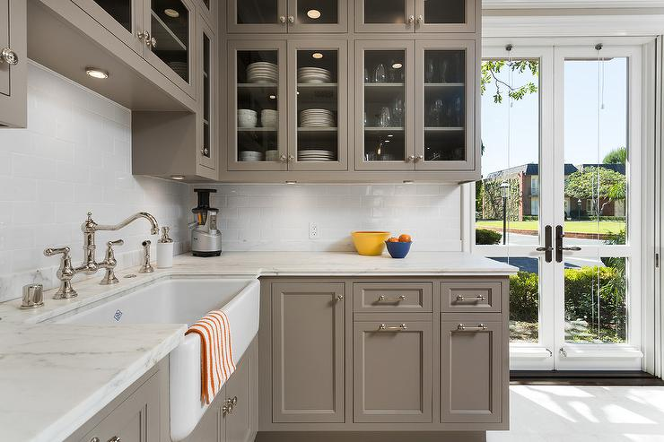 gray glass front kitchen cabinets with carrera marble on benjamin moore kitchen cabinet paint id=89493