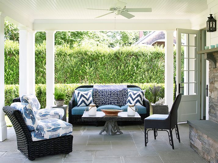 black wicker patio furniture with blue