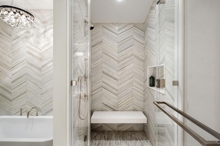 white and gray chevron shower tiles