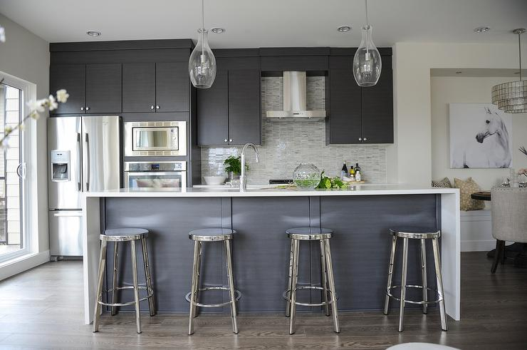 Modern Gray Kitchen with Round Chrome Counter Stools ... on Kitchen Counter Decor Modern  id=40193