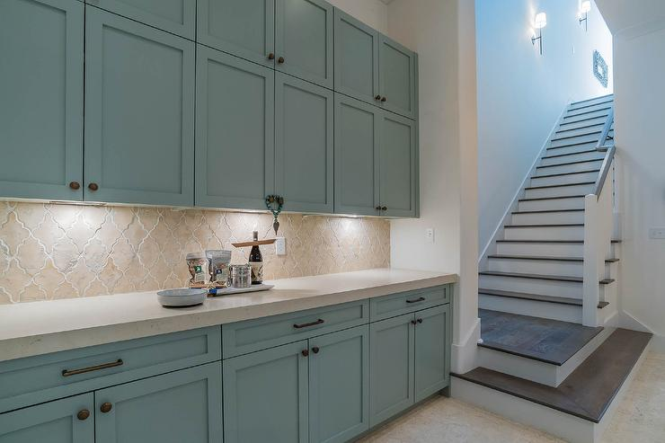 blue kitchen cabinets with arabesque