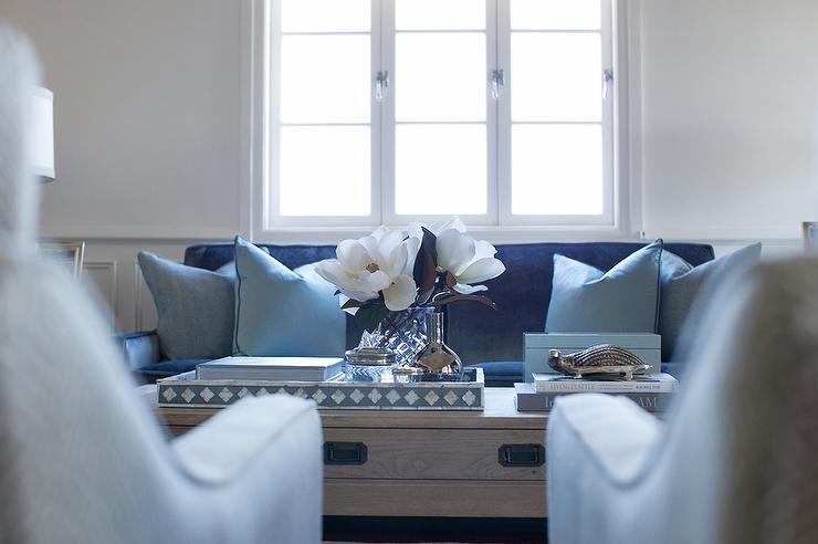 dark blue velvet sofa with light blue