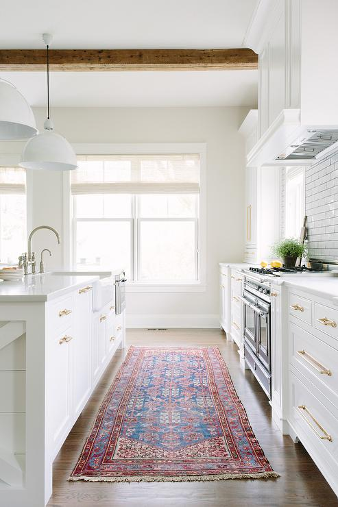 White Kitchen With Rustic Wood Ceiling Beams And Red And