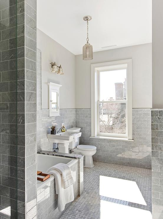 White Bathroom With Gray Marble Countertops And A Glass