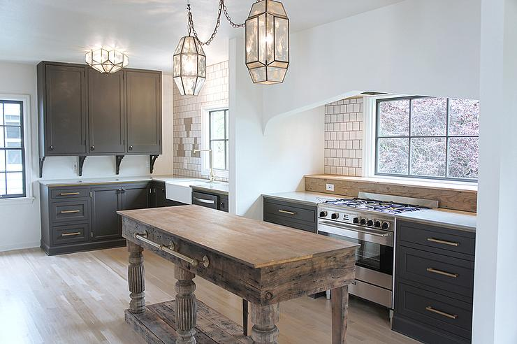 Dark Gray Kitchen Cabinets With Aged Brass Pulls And Knobs