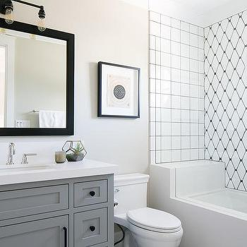 white square shower tiles with black