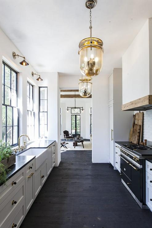 Black And White Galley Style Kitchen With Mercury Glass Pendants Transitional Kitchen