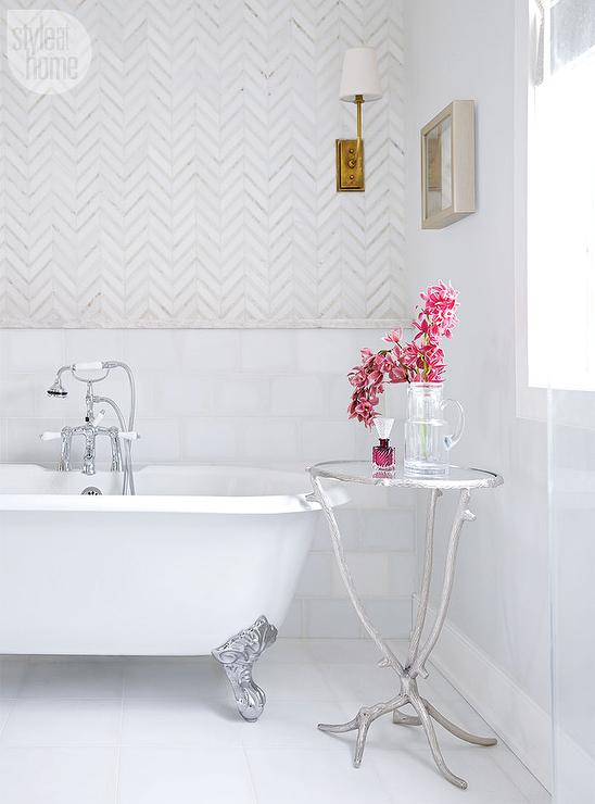 Roll Top Tub With White Herringbone Carpet Tiles Bordered