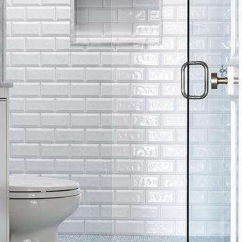 bathroom floor tiles continue into