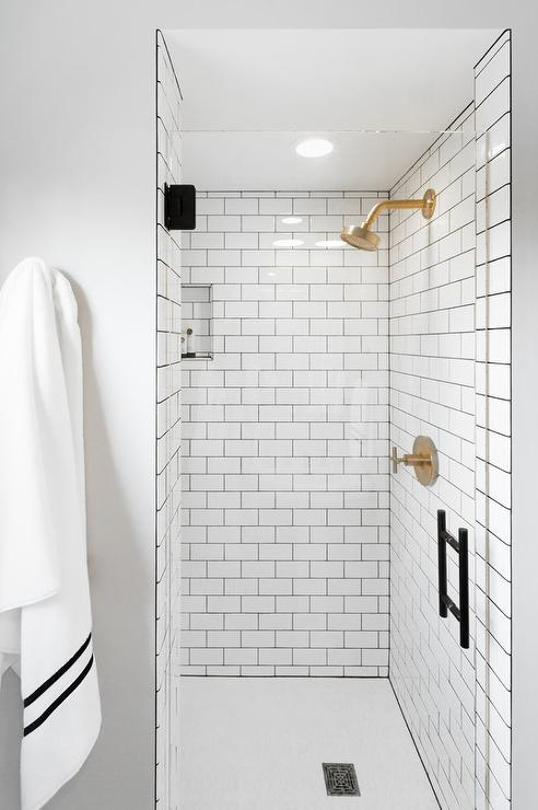gray grout and brushed gold shower head