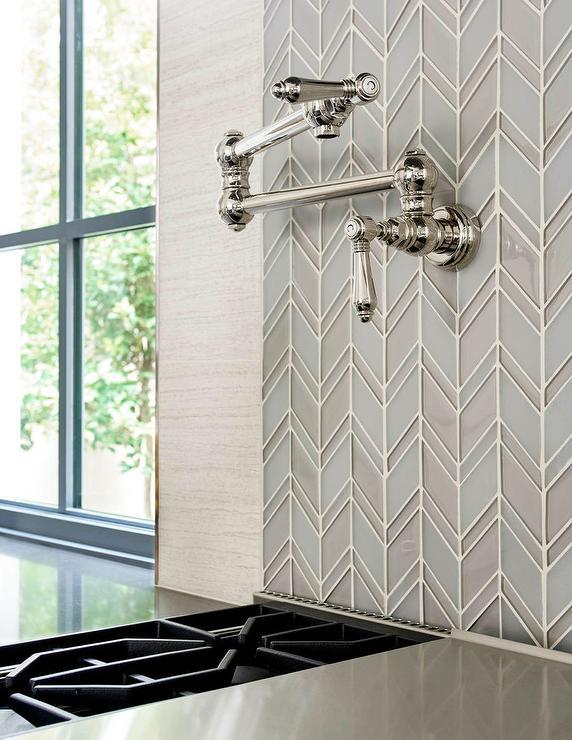 blue and gray glass herringbone tiles