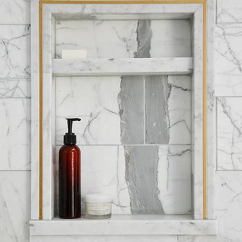 marble shower niche with gold trim