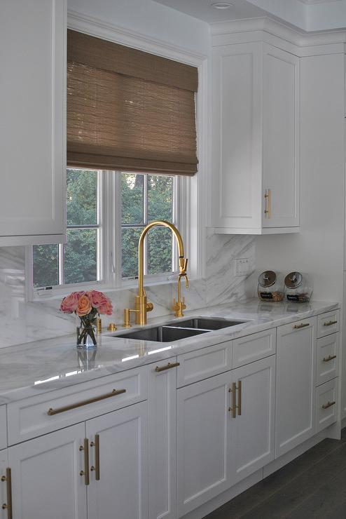 white kitchen with gold gooseneck