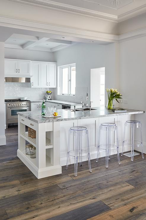 Kitchen Peninsula With Charles Ghost Bar Stools