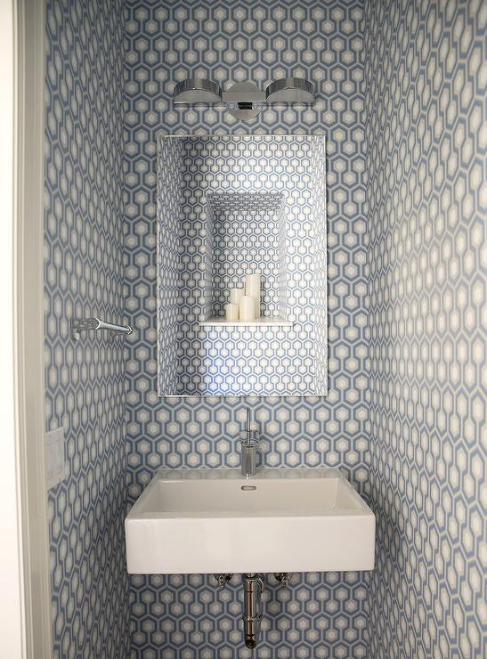 tiny blue powder room with blue hex