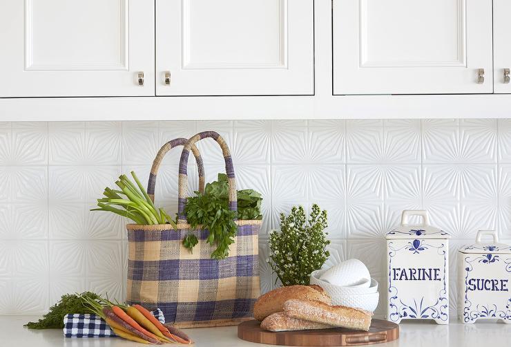 white textured kitchen backsplash tiles