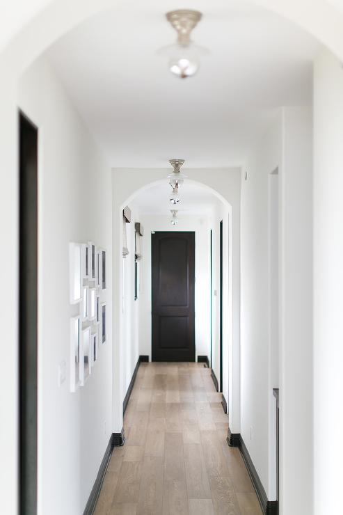 Long Hall With Arched Doorways Transitional Entrance Foyer