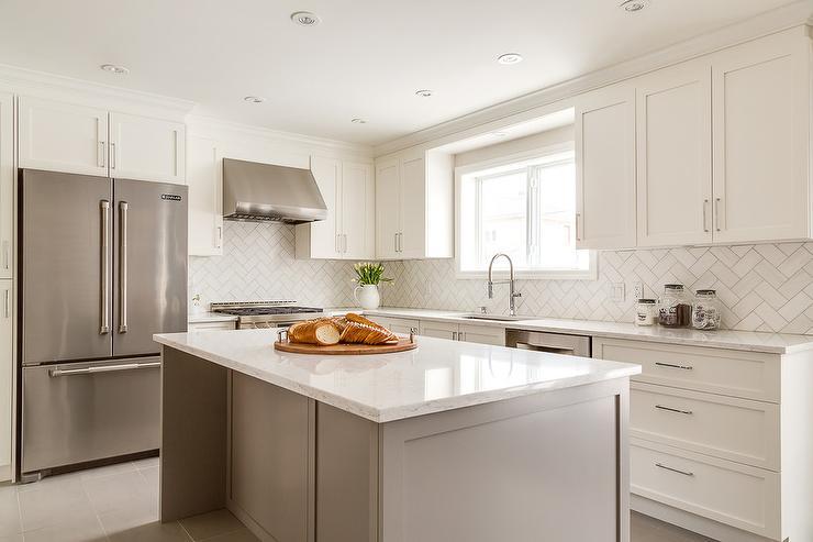 White Shaker Cabinets With White Herringbone Backsplash Transitional Kitchen