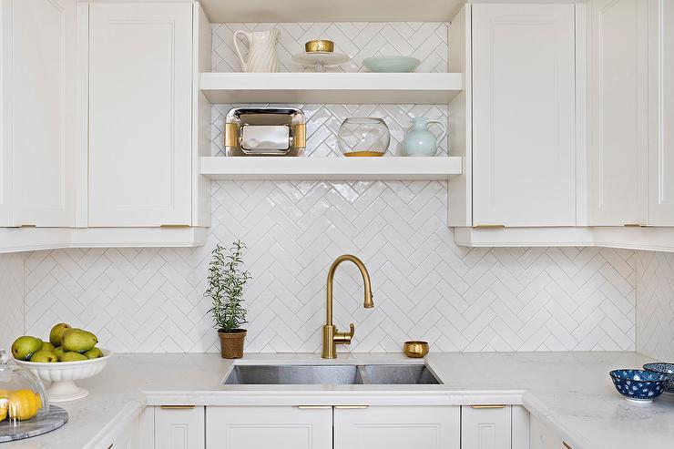 white herringbone backsplash tiles in u