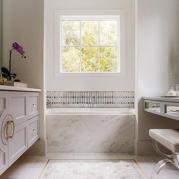 white marble tiles with gold trim