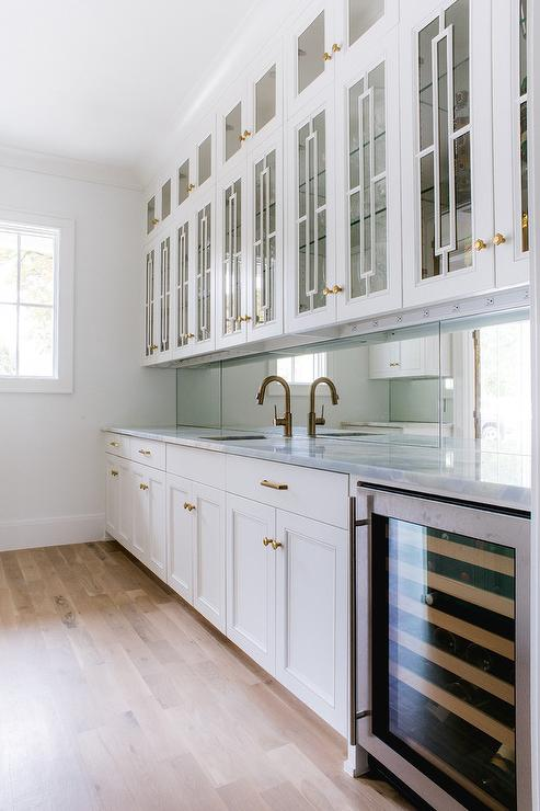 Gray Pantry Doors With Aged Brass Oval Door Knobs