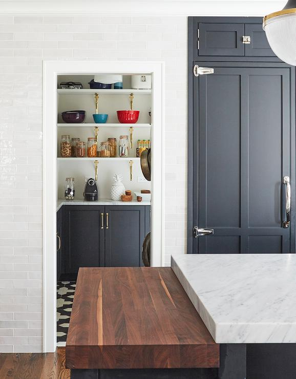 Dark Blue Pantry Cabinets With White And Gold Shelves Transitional Kitchen