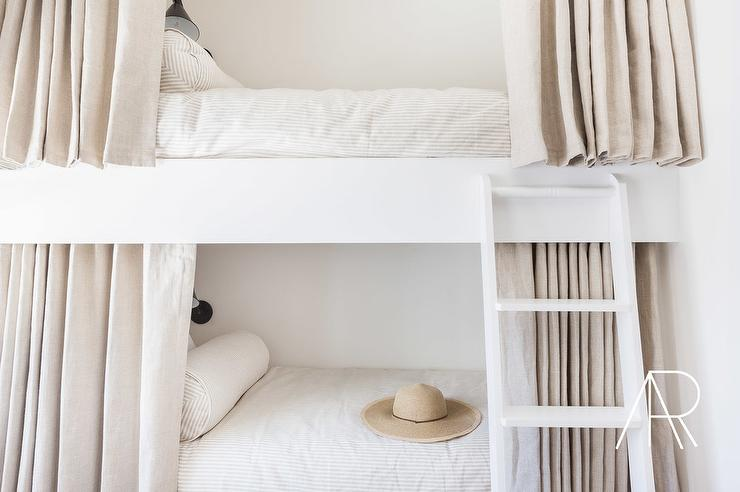 white bunk beds with light gray linen