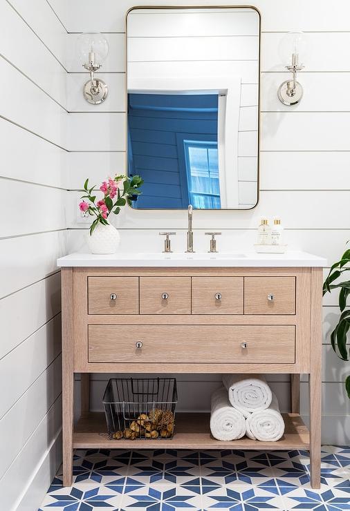Light Oak Sink Vanity With Curved Brass Mirror