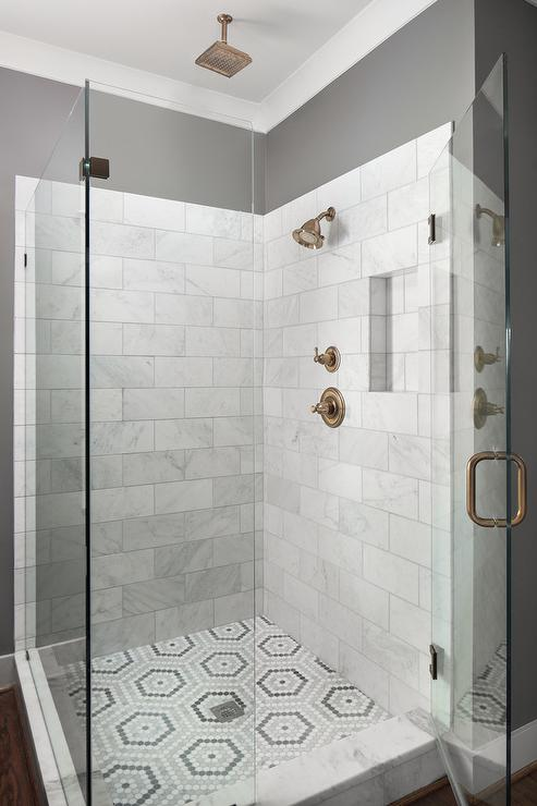 white and gray penny tiles laid out in