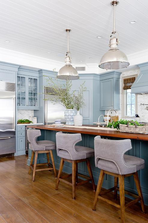 Blue Center Island With Wood Countertop Transitional Kitchen