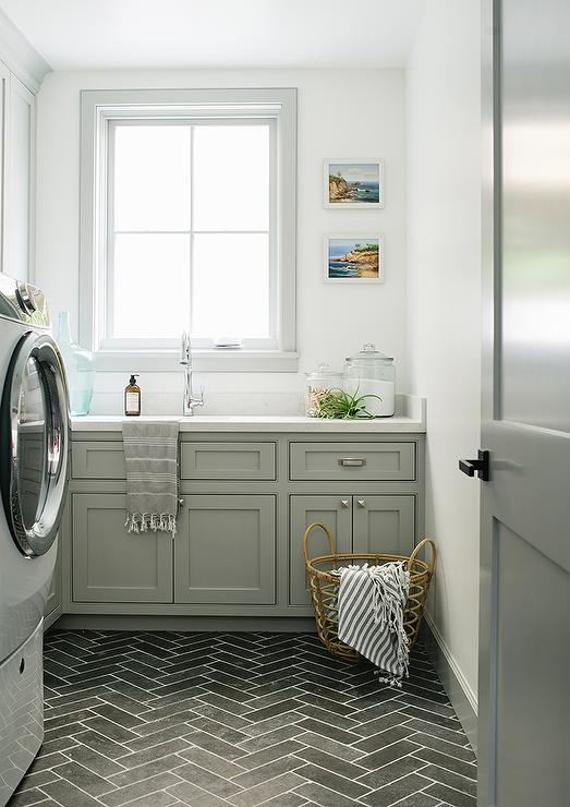 White Herringbone Backsplash Tiles With Black Grout Transitional Laundry Room