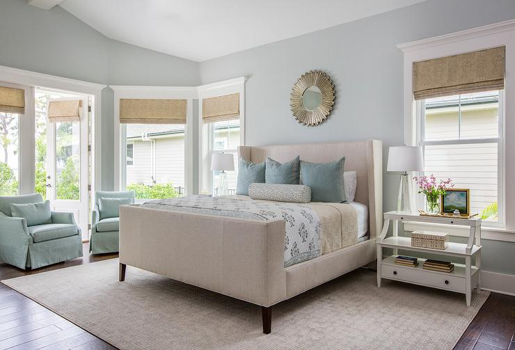 Beige Wingback Bed With Blue Pillows Transitional Bedroom