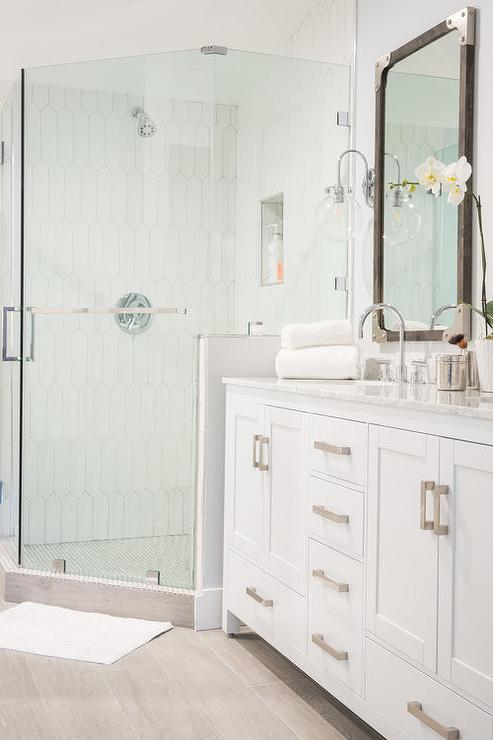 corner shower with white picket tiles