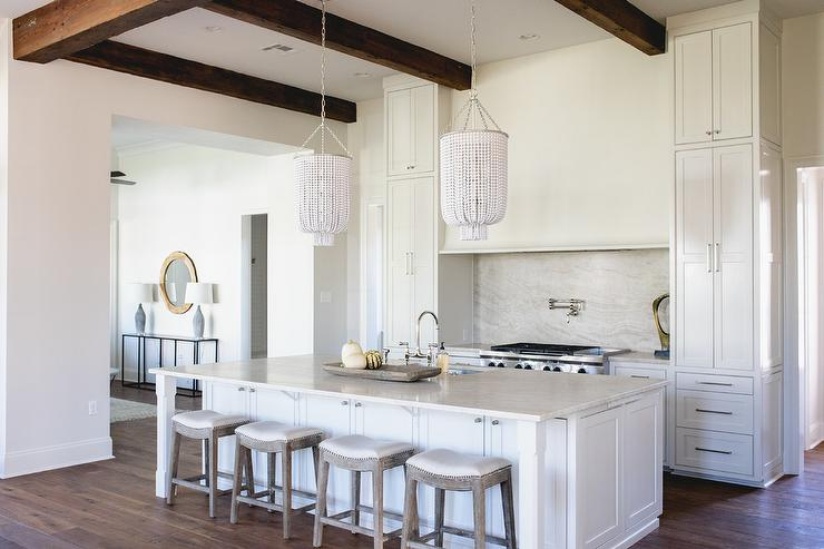 Off White Kitchen Cabinets With Light Gray Wash Herringbone Wood Floor Transitional Kitchen