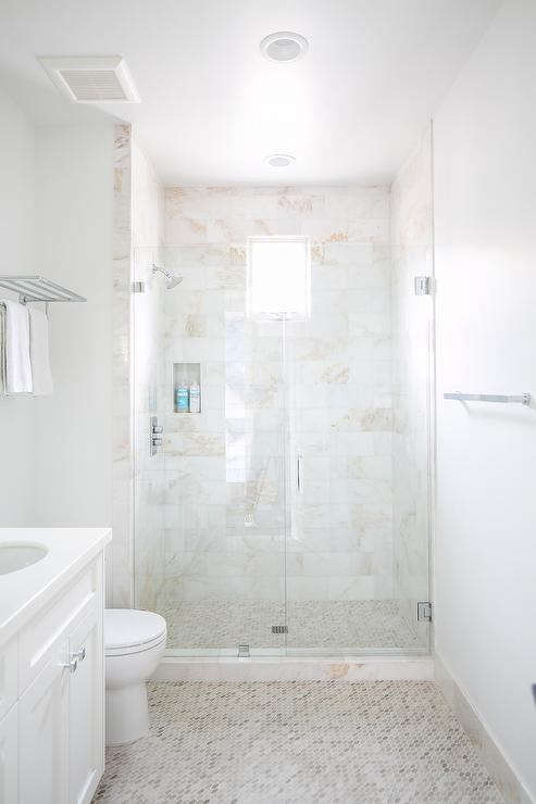 white and tan hex floor tiles with