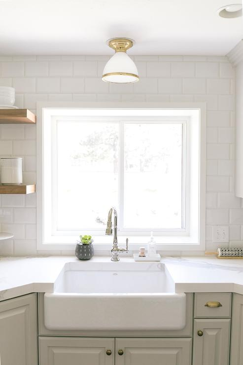 farmhouse sink under white and gold