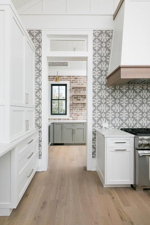 white and gray fleur de lis tiles