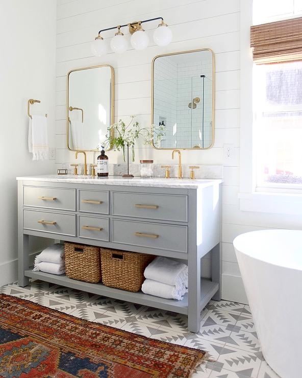 gray double sink vanity with brass