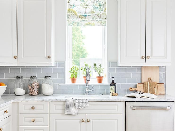 white raised panel cabinets with light
