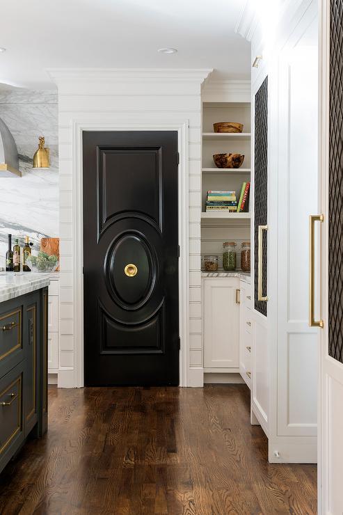 Glossy Black Pantry Door With Brass Door Knob Transitional Kitchen