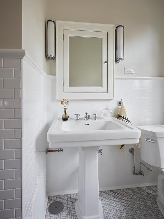 pedestal sink on marble maze floor