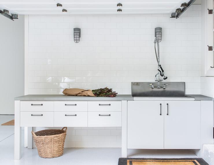 garage with utility sink and dog shower