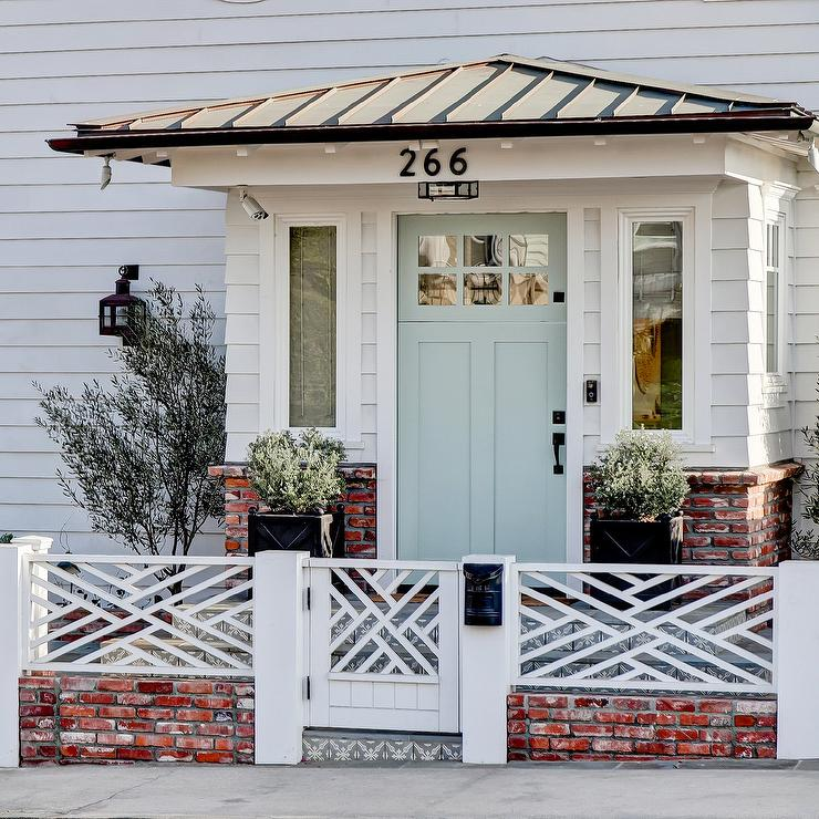light blue door on white beach cottage